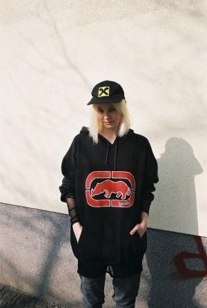 Shot and interviewed by Britta Burger for i-D International womensday portraits.Cap VINTAGE, Seethrough shirt MONKI, Jumper ECKO...