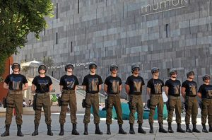 MOTA's soldiers – staging a performance in Museumsquartier – wear t-shirts with peace messages by artists from...