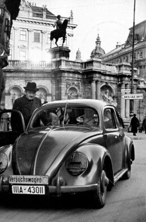 Ferdinand Porsche with a Volkswagen Beetle prototype in Vienna, c. 1940