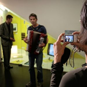 Norbert Trummer singing and playing the accordeon at the first ASIFAKEIL exhibition 2007