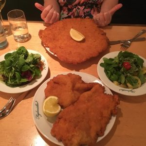 Who gives a Schnitz? (We do.) (PS: Never coming home) Figlmüller (official)