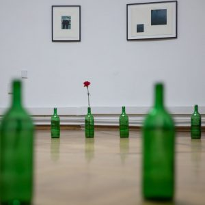 """""""Every Day a Revolution"""" by Marco Godinho, 2018 Standard wine bottles are placed on the ground in..."""