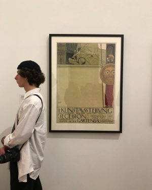 Gallery visitor with poster by Klimt