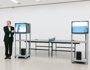 "Here you can see artist Ernst Caramelle standing next to his work ""Video Ping-Pong"", which he created..."