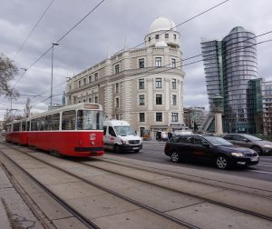 Red and white #vienna #urban #mondaymorning #hustleandbustle #streets #tram #cars #movement #uraniapalace #citylife #redandwhite #austria #architecture #buildings...