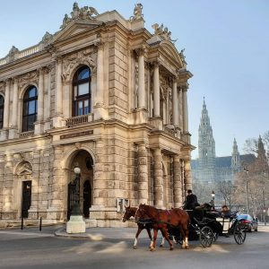 At the backside of the Burgtheater, with the Vienna City Hall in the background . . ....