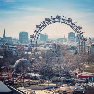 The Vienna Giant Ferris Wheel on the Vienna Prater and view of the skyline of Vienna. ....