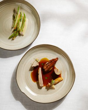 Kid goat with green asparagus, hop sprouts & rhubarb #eastertradition #inspiredbynature #foodofaustria #worlds50best ...