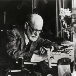 "Sigmund Freud working on ""Moses and Monotheism"", published in 1939. His corrections on the typoscript are on display..."