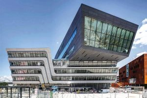 The new Library and Learning Centre rises as a polygonal block from the heart of the new...