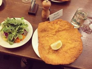 One large schnitzel - see pepper shaker for size comparison #figlmuller #vienna #europe #dulicieux #dulicieuxtravels