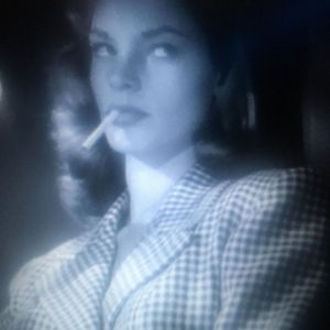 Lauren Bacall seen here smoking cigarettes at age 20 in the movie To Have and Have Not,...