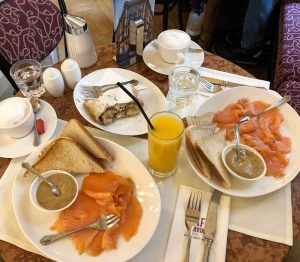 Salmon toast with mustard, apple strudel, traditional Viennese coffee, and Claudia's basic orange ...