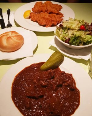 Delicious Viennese Schnitzel and beef goulash, so good! Glacis Beisl