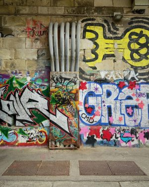 The concrete walls aligning kilometres of the Danube Canal are like one long blank canvas, inviting graffiti/street...