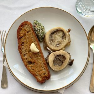 Bone marrow madness in Vienna! Grilled veal bone marrow with toasted bread and minced capers, onions and...
