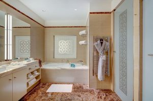 Take a sip of champagne and relax in the bathtub in our beautifully ...