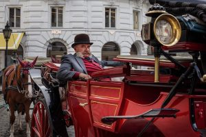A Fiaker next to the Hofburg Palace is waiting for tourists taking a ...