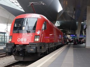 OBB Taurus 1116 119 sits on the front of a RailJet service heading for Vienna Airport. •••...