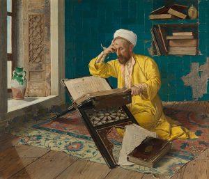 Tief in die Lektüre versunken beugt sich ein Gelehrter über den Koran. In seinem leuchtend gelben Seidengewand...